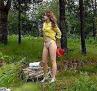 Raunchy babe gets stripped and pisses in the woods