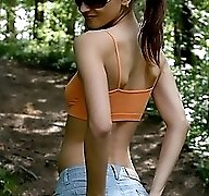 Pigtailed teen with perfect body tinkles in forest