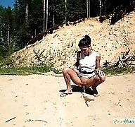 Charming hoochie in glasses pissing into the sand