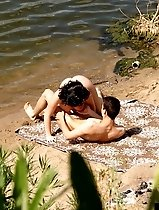 Beach lovers massage each other with lips and tongues