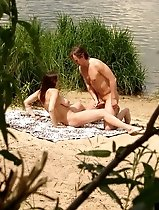 Busty chick doing the do with a fucky dude on a beach