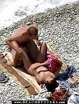 Happy nudist couple have slow sex near the water