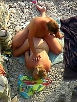 Full-bodied blonde fucked from behind on a beach