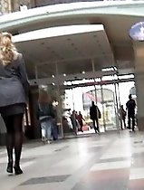 Upskirt movie of two identically dressed cuties...