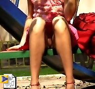Voyeur upskirt of a girl flashing pussy on the playground